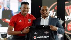 Ian Wright holding an Orlando Pirates top