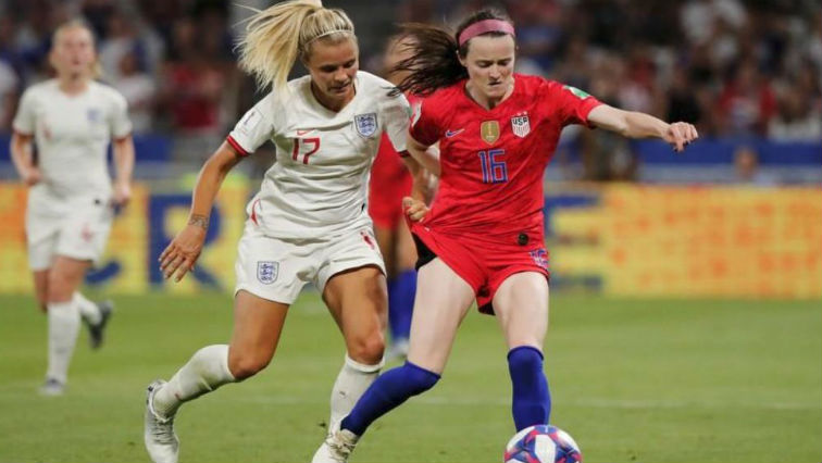 FILE PHOTO: Rose Lavelle of the US in action with England's Rachel Daly.