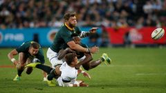 England's Henry Slade in action with South Africa's Duane Vermeulen.