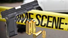 A gun, bullets and crime scene tape