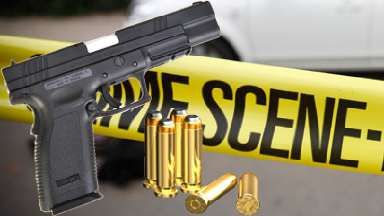 A gun, bullets and crime scene tape