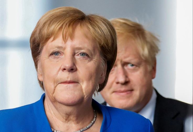 German Chancellor Angela Merkel and Britain's Prime Minister Boris Johnson attend a news conference at the Chancellery in Berlin