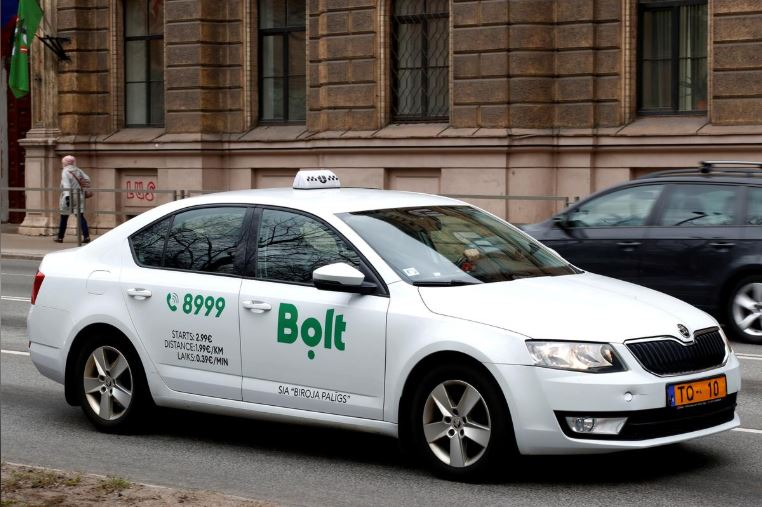 A Bolt (formerly known as Taxify) sign is seen on the taxi car in Riga.