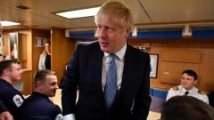 Britain's Prime Minister Boris Johnson meets crew members during a visit to HMS Victorious at HM Naval Base Clyde.