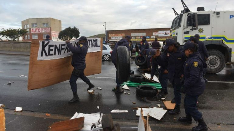 police used teargas and stun grenades to disperse crowds in Kensington near the CBD.