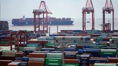 Containers are seen at the Yangshan Deep Water Port in Shanghai, China
