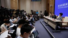 Yang Guang (C) and Xu Luying (R) of the Hong Kong and Macau Affairs Office of the State Council attends a news conference on the current situation in Hong Kong.