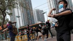 Protesters hurl objects at the police during a demonstration in support of the city-wide strike and to call for democratic reforms at Tin Shui Wai in Hong Kong.