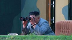 North Korean leader Kim Jong Un watches the test-fire of two short-range ballistic missiles on Thursday.