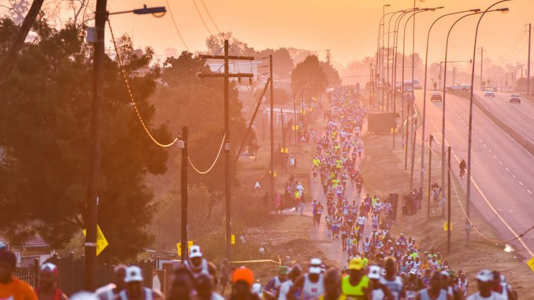 Runners of the 2017 Mandela Marathon make their way through Edendale. photo. Jonathan Burton.