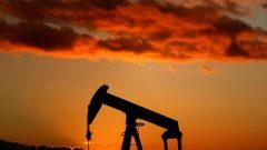 An oil pump is seen at sunset outside Scheibenhard, near Strasbourg.