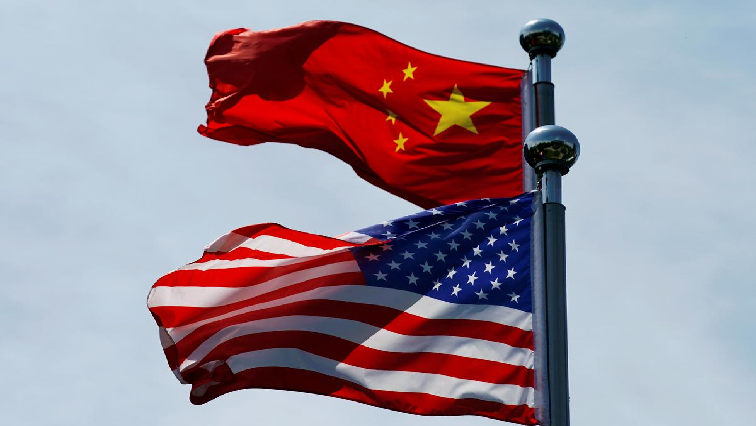 SABC News US flag China flag R - China vows fight against Trump's latest tariffs as stocks sink