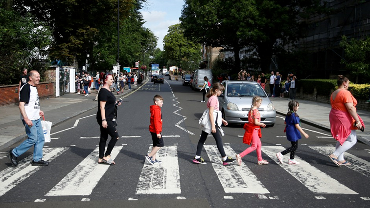 SABC News abbey road R - Crowds gather to mark 50th anniversary of the Beatles' Abbey Road album photo