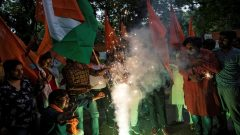 People burn firecrackers as they celebrate after the government scrapped the special status for Kashmir