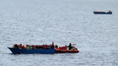 """Migrants on a wooden boat are rescued by German NGO Jugend Rettet ship """"Juventa"""" crew in the Mediterranean sea off Libya coast."""