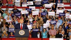 Donald Trump with Women holding placards