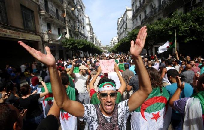 Demonstrators shout slogans during a protest to reject the Algerian election announcement for December, in Algiers, Algeria.