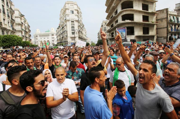 Demonstrators gesture and shout slogans during a protest rejecting Algerian election announcement for December, in Algiers, Algeria.