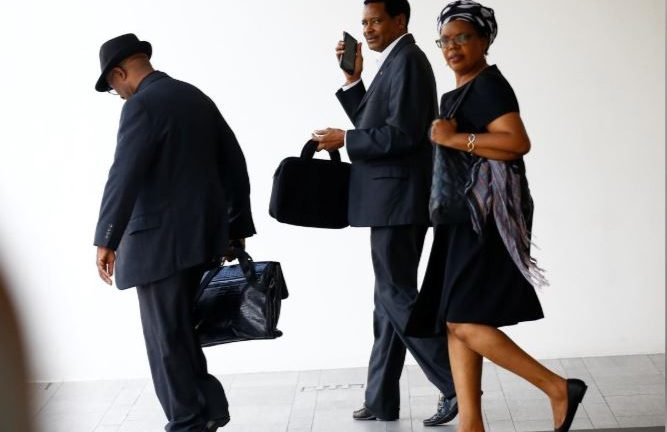 Zimbabwe's charge d'affaires Claudius Nhema and other visitors leave after attending a private religious service at Singapore casket. The funeral parlour where the body of the late Robert Mugabe is being held in Singapore.