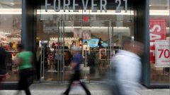People walk by the clothing retailer Forever 21 in New York City.