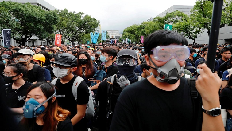 SABC News HK Reuters - Fitch downgrades Hong Kong after months of protests