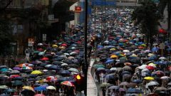 People march during a protest in Kwai Fong, in Hong Kong, China.
