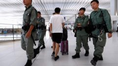 Riot police patrol inside Hong Kong International Airport in Hong Kong, China.