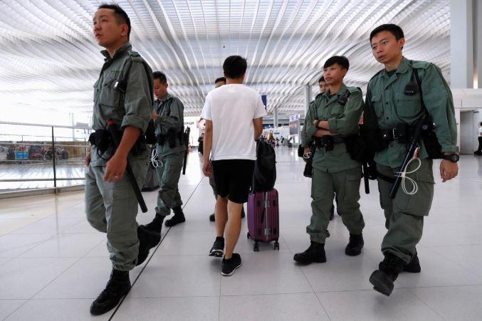 Riot police patrol inside Hong Kong International Airport in Hong Kong, China.