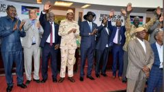 Sudanese officials, rebels and diplomats react after signing the initial agreement on a roadmap for peace talks in Juba, South Sudan.