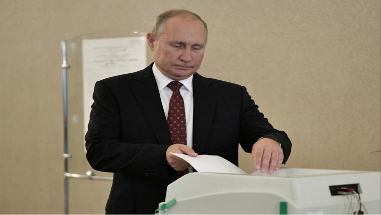 Vladimir Putin casting a vote
