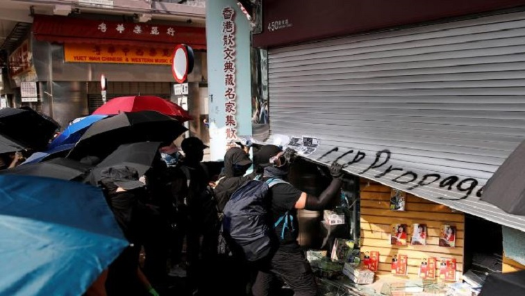 Anti-government demonstrators vandalize a shop during a protest in Hong Kong.