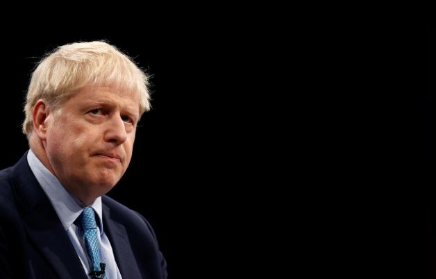 Britain's Prime Minister Boris Johnson gives a closing speech at the Conservative Party annual conference in Manchester.