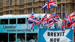 A passenger bus passes a pro-Brexit demonstration in Westminster, London, Britain, September 30, 2019.