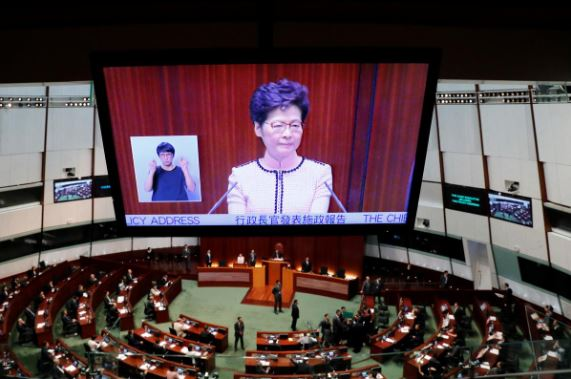 Hong Kong Chief Executive Carrie Lam is seen on a screen as she reacts to protests by pro-democracy lawmakers, at the Legislative Council in Hong Kong.