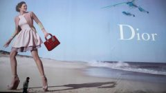 A man walks past a Dior advertisement outside a shopping mall in Wuhan, Hubei province.