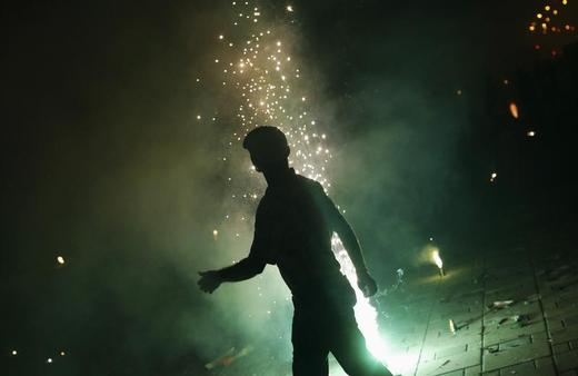 A man lights firecrackers celebrating the Hindu festival of Diwali, the annual festival of lights, in Mumbai.