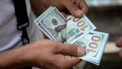 A man counts U.S. dollars in Tehran.