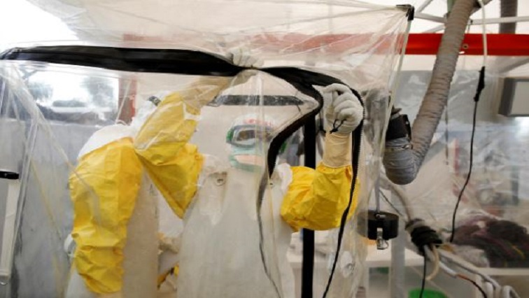 A health worker wearing Ebola protection gear enters the Biosecure Emergency Care Unit (CUBE) at the ALIMA (The Alliance for International Medical Action) Ebola treatment centre in Beni.