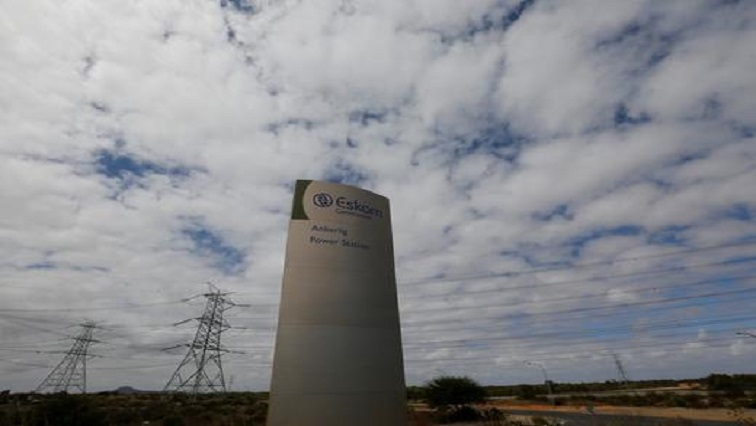 Pylons carry electricity from a sub-station of state power utility Eskom outside Cape Town.