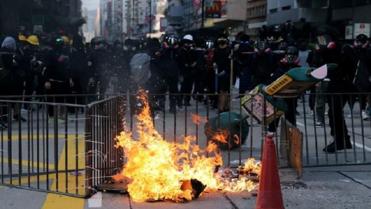 Anti-government demonstrators set a barricade on fire during a protest in Hong Kong, China.