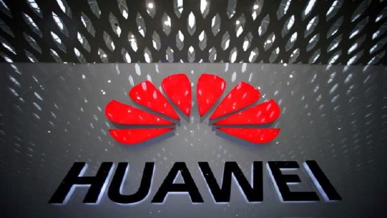A Huawei company logo is pictured at the Shenzhen International Airport in Shenzhen, Guangdong province.