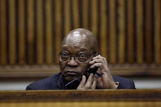 Former South African President Jacob Zuma speaks on the phone during the court appearance.