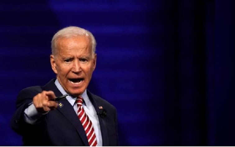 Democratic 2020 US presidential candidate and former Vice President Joe Biden reacts during a televised townhall on CNN dedicated to LGBTQ issues in Los Angeles.