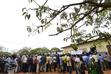 Voters queue to cast their ballots in municipal elections at a voting station near Gorongosa in central Mozambique.