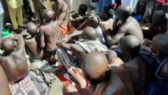 Men and boys are pictured after being rescued by police in Sabon Garin, in Daura local government area of Katsina state.