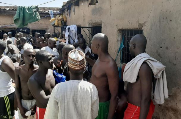 People are pictured after being rescued by police in Sabon Garin, in Daura local government area of Katsina state, Nigeria.