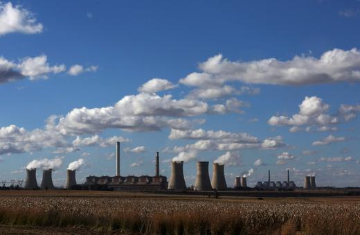 Steam rises from the cooling towers of Matla Power Station, a coal-fired power plant operated by Eskom in Mpumalanga.