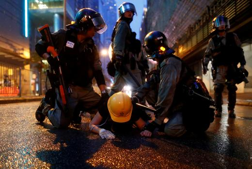 Riot police detain a demonstrator during a protest in Tsuen Wan, in Hong Kong.