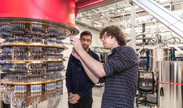 A handout picture from October 2019 shows Sundar Pichai and Daniel Sank (R) with one of Google's Quantum Computers in the Santa Barbara lab, California.