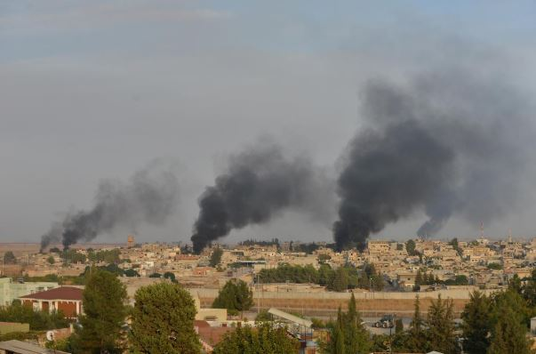 Smoke rises from the Syrian border town of Ras al-Ain as it is pictured from the Turkish town of Ceylanpinar in Sanliurfa province, Turkey, October 9.